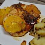 Schweinerücken mit gebratenen Orangen und Kartoffeln